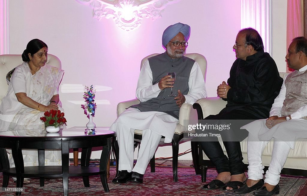 Indian Prime Minister Manmohan Singh talking with senior BJP leader Arun Jaitley as Shusma Swaraj looks during wedding reception of BJP president Nitin Gadkar's son Sarang Gadkari's on July 2, 2012 in New Delhi, India. Nitin Gadakari's younger son Sarang tied knot with his classmate Madhura on June 24, 2012 in Nagpur.