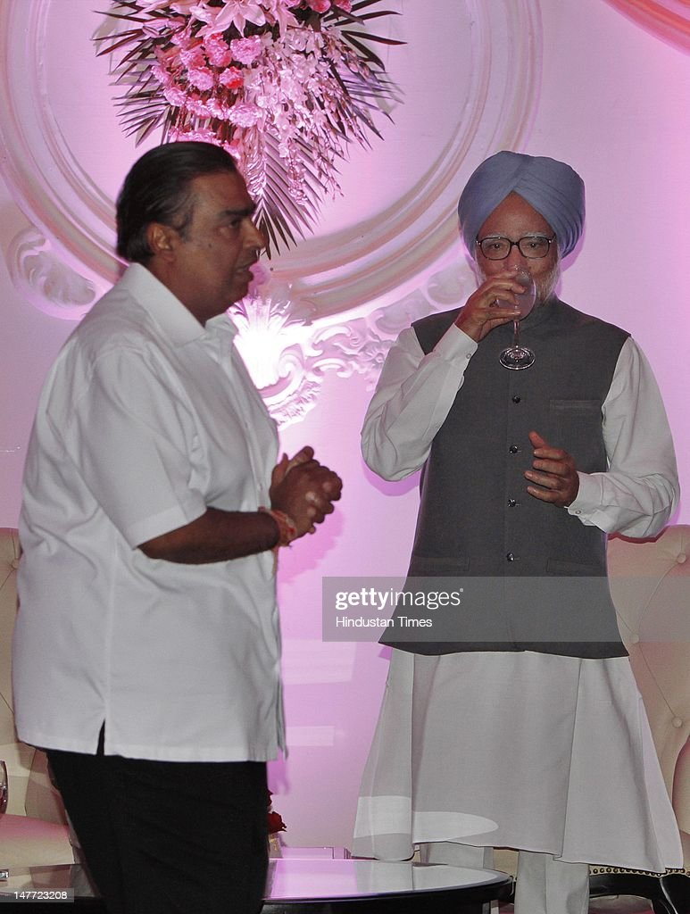 Indian Prime Minister Manmohan Singh with Industrialist Mukesh Ambani during wedding reception of BJP president Nitin Gadkar's son Sarang Gadkari's on July 2, 2012 in New Delhi, India. Nitin Gadakari's younger son Sarang tied knot with his classmate Madhura on June 24, 2012 in Nagpur.