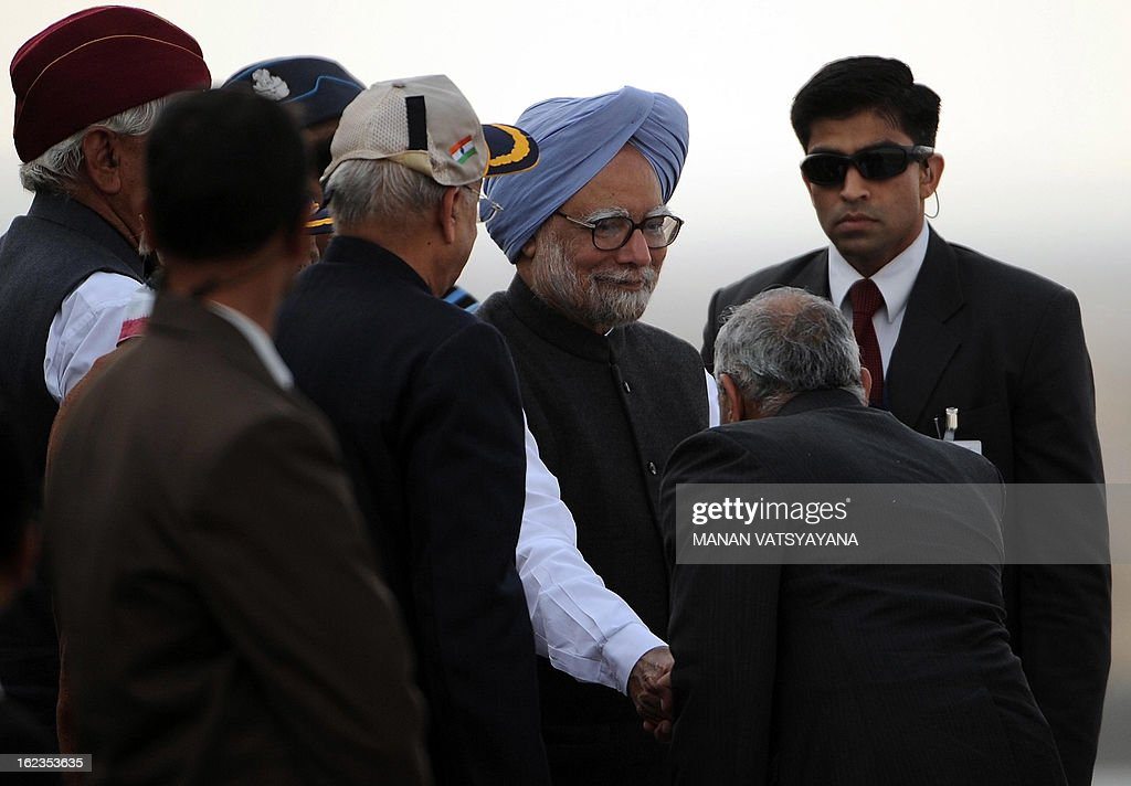 Indian Prime Minister ManmohanSingh (3R) arrives to witness the Iron Fist 2013 firepower demonstration exercise in Pokhran on February 22, 2013. IAF held the Iron Fist 2013 exrecise to showcase its operational capabilities during day, dusk and night, taking out simulated targets with precison laser-guided weaponry. AFP PHOTO/ MANAN VATSYAYANA