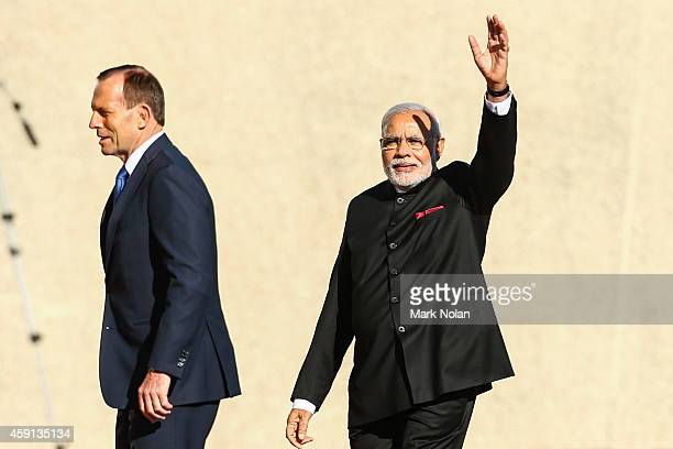 Indian Prime Minister Narendra Modi acknowledges supporters after inspecting the gaurd at Parliament House on November 18 2014 in Canberra Australia...