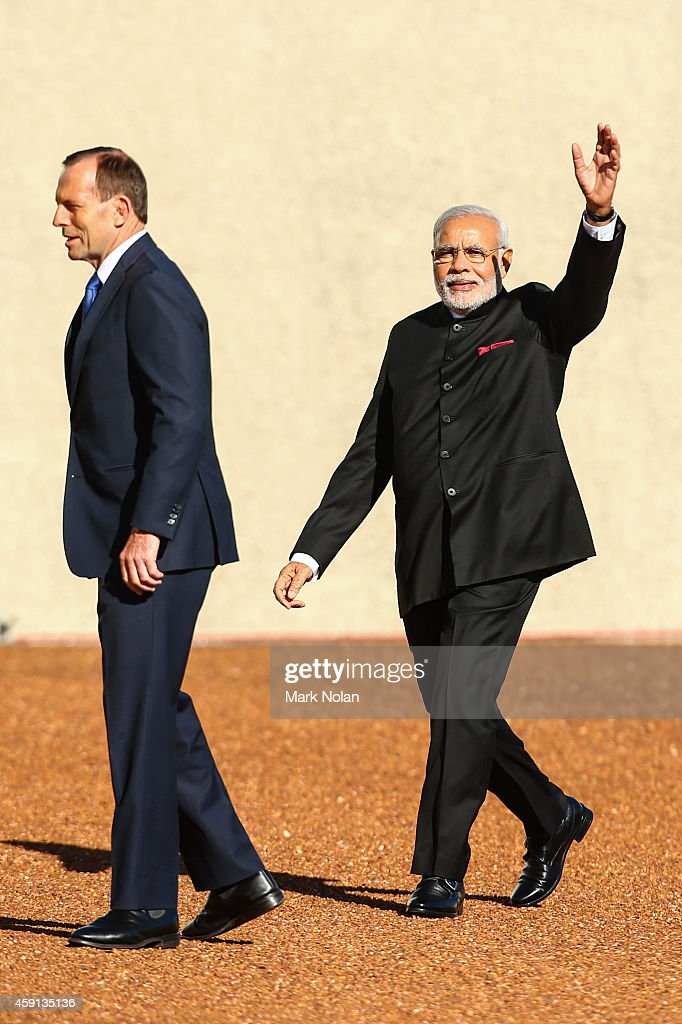 Indian Prime Minister <a gi-track='captionPersonalityLinkClicked' href=/galleries/search?phrase=Narendra+Modi&family=editorial&specificpeople=822611 ng-click='$event.stopPropagation()'>Narendra Modi</a> acknowledges supporters after inspecting the gaurd at Parliament House on November 18, 2014 in Canberra, Australia. Prime Minister <a gi-track='captionPersonalityLinkClicked' href=/galleries/search?phrase=Narendra+Modi&family=editorial&specificpeople=822611 ng-click='$event.stopPropagation()'>Narendra Modi</a> is attending meetings in Sydney, Canberra and Melbourne following the G20 Leaders Summit in Brisbane.