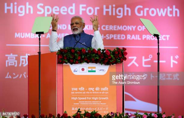 Indian Prime Minister Narendra Modi addresses during the groundbreaking ceremony of the high speed train project using Japanese technology on...
