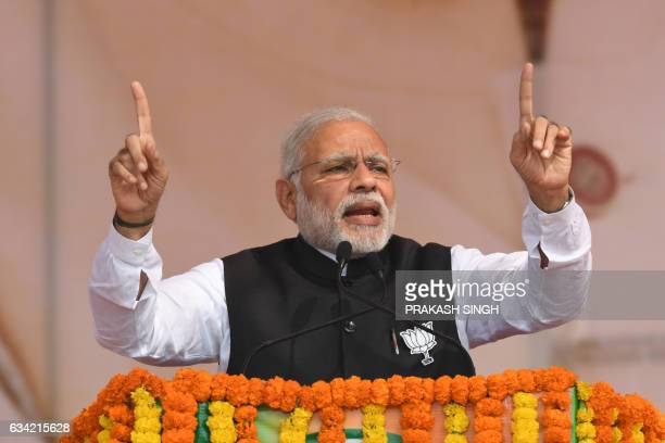 Indian Prime Minister Narendra Modi and Bharatiya Janata Party leader gestures as he addresses a state assembly election rally in Ghaziabad on...
