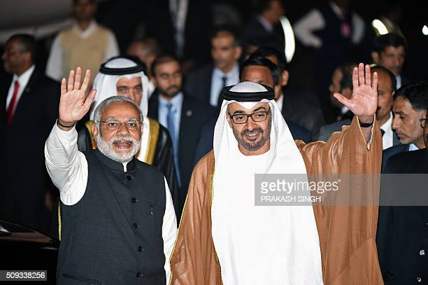 Indian Prime Minister Narendra Modi and Crown Prince of Abu Dhabi Sheikh Mohammed Bin Zayed Al Nahyan wave to the crowd after the prince arrived at...