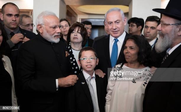Indian Prime Minister Narendra Modi and Israeli Prime Minister Benjamin Netanyahu meet with Moshe Holtzberg son of slain US Rabbi Gavriel Holtzberg...