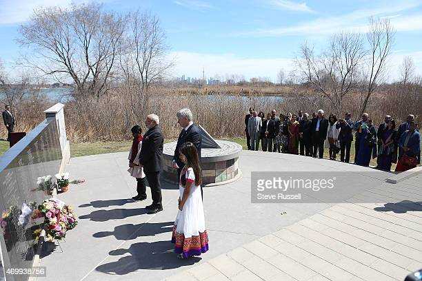 TORONTO ON APRIL 16 Indian Prime Minister Narendra Modi and Prime Minister Stephen Harper take a moment of silence after laying wreaths during a...