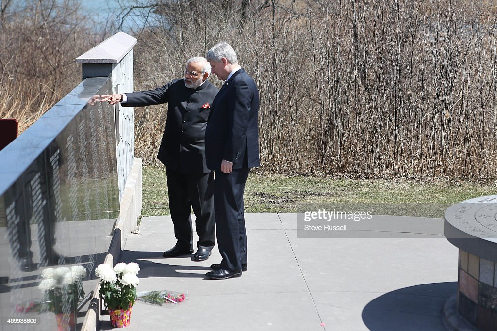 TORONTO, ON- APRIL 16 - Indian Prime Minister <a gi-track='captionPersonalityLinkClicked' href=/galleries/search?phrase=Narendra+Modi&family=editorial&specificpeople=822611 ng-click='$event.stopPropagation()'>Narendra Modi</a> and Prime Minister <a gi-track='captionPersonalityLinkClicked' href=/galleries/search?phrase=Stephen+Harper+-+Politician&family=editorial&specificpeople=690870 ng-click='$event.stopPropagation()'>Stephen Harper</a> take in the monument after laying wreaths during a visit to the Air India Flight 182 monument at Humber Bay East Park in Toronto. April 16, 2015. Air India Flight 182 flying on the Montreal, CanadaLondon, UK Delhi, India route on June 23, 1985, when a bomb destroyed the Boeing 747 over the Atlantic Ocean near Ireland.