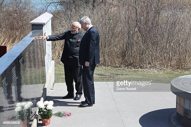 TORONTO ON APRIL 16 Indian Prime Minister Narendra Modi and Prime Minister Stephen Harper take in the monument after laying wreaths during a visit to...