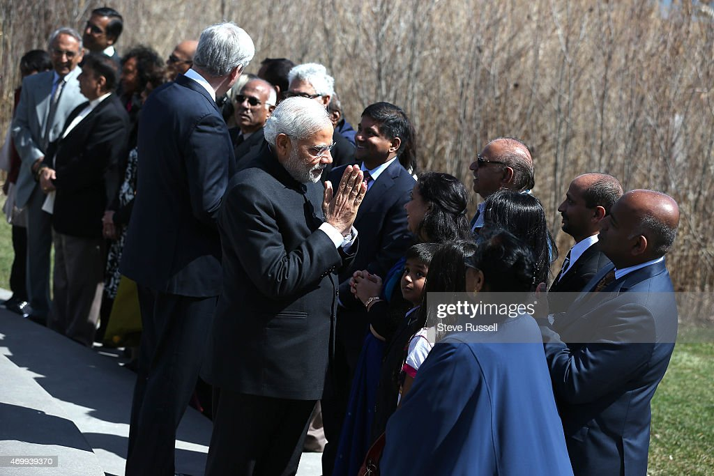 TORONTO, ON- APRIL 16 - Indian Prime Minister <a gi-track='captionPersonalityLinkClicked' href=/galleries/search?phrase=Narendra+Modi&family=editorial&specificpeople=822611 ng-click='$event.stopPropagation()'>Narendra Modi</a> and Prime Minister <a gi-track='captionPersonalityLinkClicked' href=/galleries/search?phrase=Stephen+Harper+-+Politician&family=editorial&specificpeople=690870 ng-click='$event.stopPropagation()'>Stephen Harper</a> greet families of the victims of Flight 182 near the monument after laying wreaths during a visit to the Air India Flight 182 monument at Humber Bay East Park in Toronto. April 16, 2015. Air India Flight 182 flying on the Montreal, CanadaLondon, UK Delhi, India route on June 23, 1985, when a bomb destroyed the Boeing 747 over the Atlantic Ocean near Ireland.