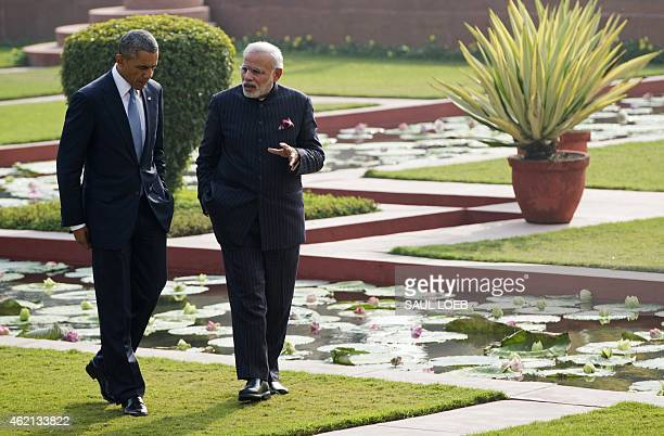 Indian Prime Minister Narendra Modi and US President Barack Obama walk through the gardens between official meetings at Hyderabad House in New Delhi...