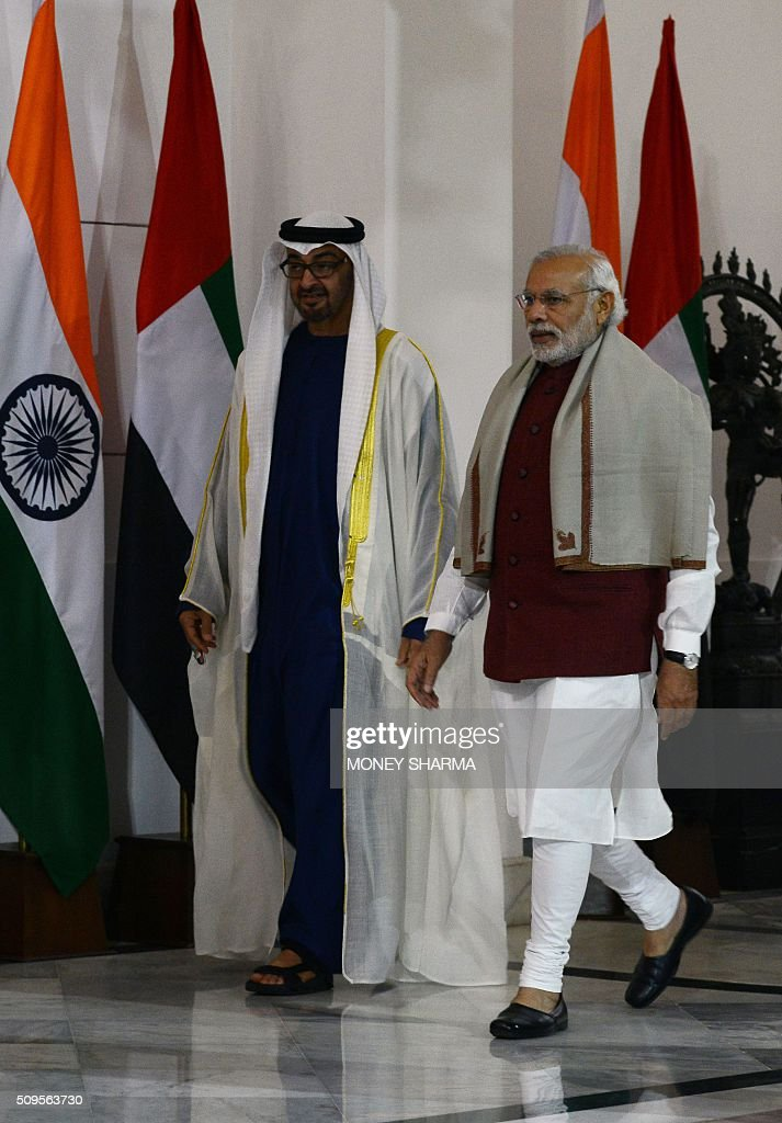 Indian Prime Minister Narendra Modi (R) arrives with Abu Dhabi's Crown Prince Sheikh Mohammed bin Zayed al-Nahyan at Hyderabad House in New Delhi on February 11, 2016. The crown prince is on three-day state visit to India until February 12. AFP PHOTO / Money SHARMA / AFP / MONEY SHARMA