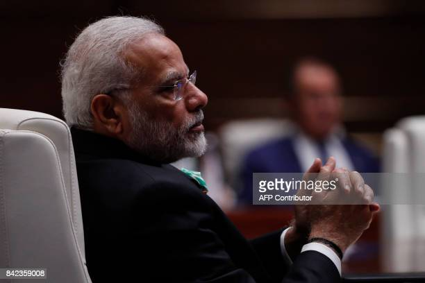 Indian Prime Minister Narendra Modi attends a plenary session during the BRICS Summit at the Xiamen International Conference and Exhibition Center in...