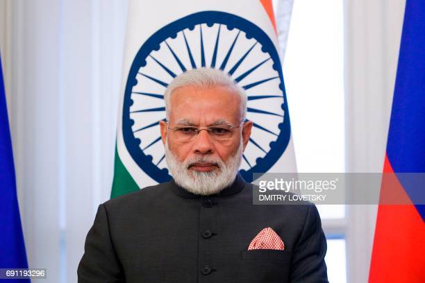 Indian Prime Minister Narendra Modi attends a signing ceremony following a meeting with Russian President on the sidelines of the St Petersburg...