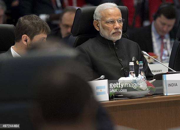 Indian Prime Minister Narendra Modi attends a working session on the Global Economy during the G20 summit in Antalya on November 15 2015 Leaders from...