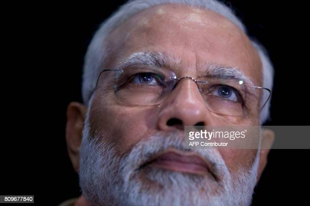 Indian Prime Minister Narendra Modi attends an innovation conference with Israeli and Indian CEOs in Tel Aviv on July 6 2017 / AFP PHOTO / POOL /...