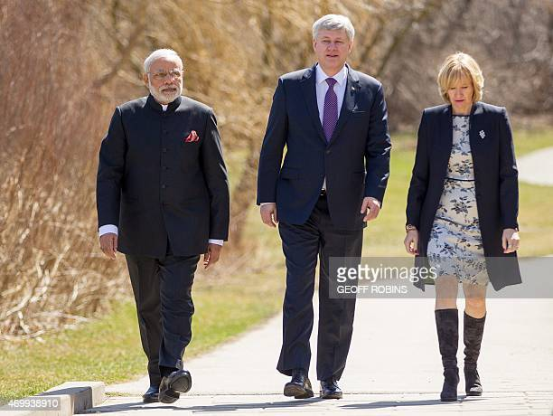 Indian Prime Minister Narendra Modi Canadian Prime Minister Stephen Harper and his wife Laureen arrive at the Toronto memorial to the 1985 Air India...