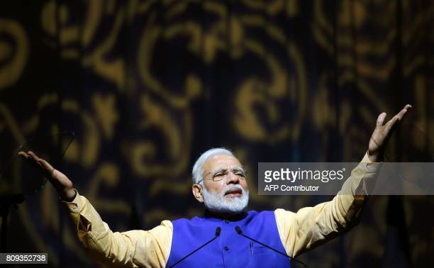 Indian Prime Minister Narendra Modi delivers a speech during a meeting with Indian community at the Tel Aviv Convention Center in the Israeli coastal...