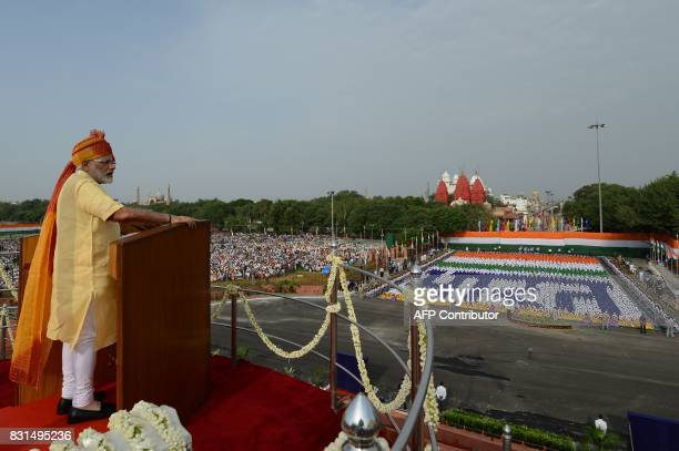 TOPSHOT Indian Prime Minister Narendra Modi delivers his speech as schoolchildren sit in formation forming Hindi script that reads 'Bharat' during...
