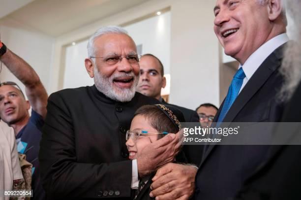 Indian Prime Minister Narendra Modi embraces Moshe Holtzberg son of slain US Rabbi Gavriel Holtzberg who was killed with his wife in the November 26...