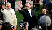Indian Prime Minister Narendra Modi French President Francois Hollande and Indian President Pranab Mukherjee wave to the media at a Republic Day...