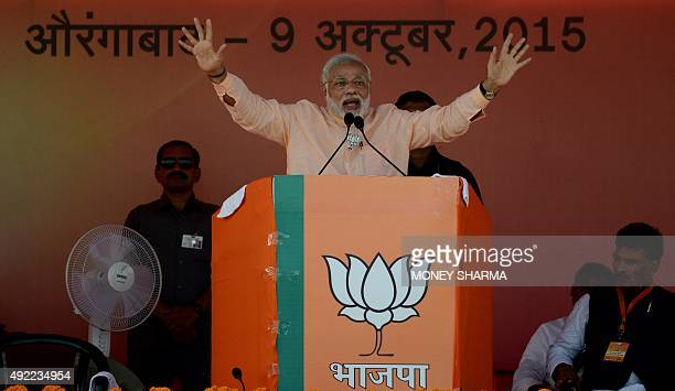 Indian Prime Minister Narendra Modi gestures as he delivers a speech during an election rally in Aurangabad in Bihar on October 9 2015 Prime Minister...
