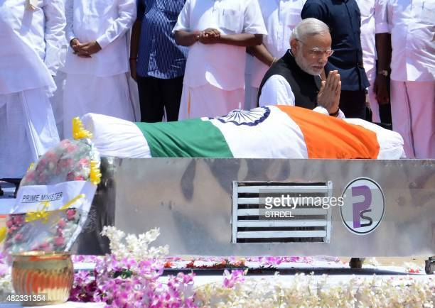 Indian Prime Minister Narendra Modi gestures as he pays tribute to former President APJ Abdul Kalam during his funeral ceremony at The Pei Karumbu...