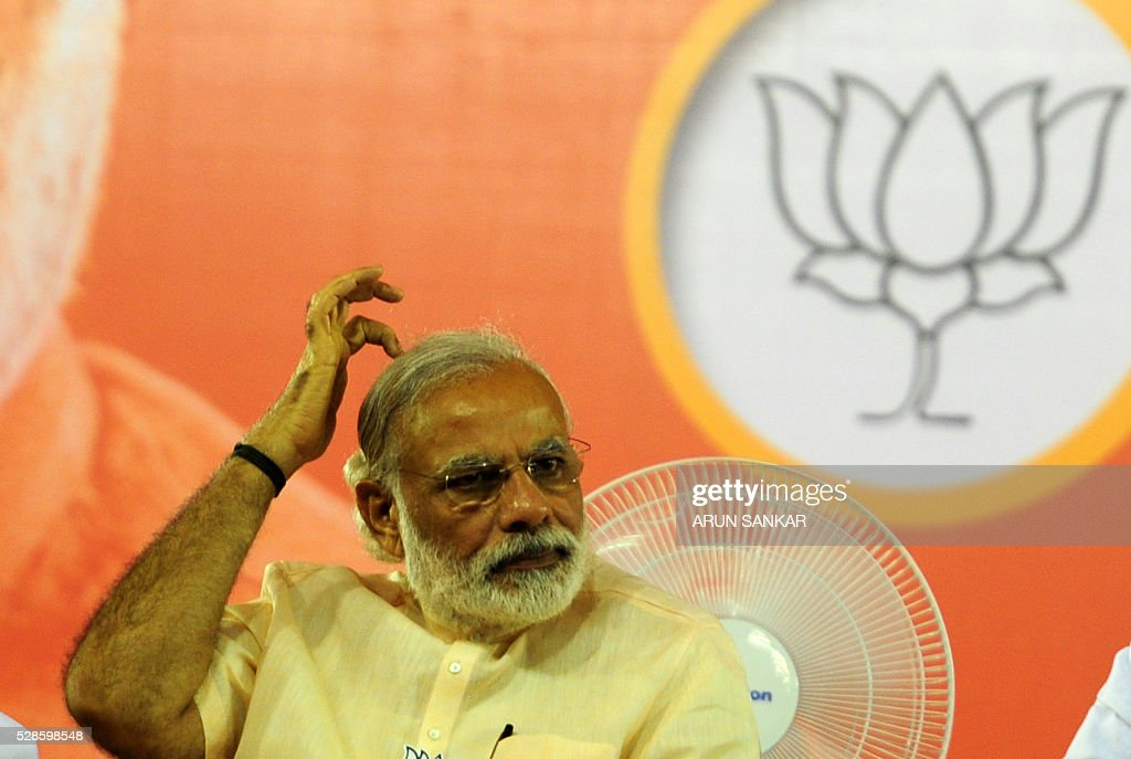 Indian Prime Minister Narendra Modi gestures as he prepares to address an election rally of Bharatiya Janata Party(BJP)supporters at The YMCA Grounds in Chennai on May 6, 2016, ahead of voting in state assembly elections in the southern Indian state of Tamil Nadu. / AFP / ARUN