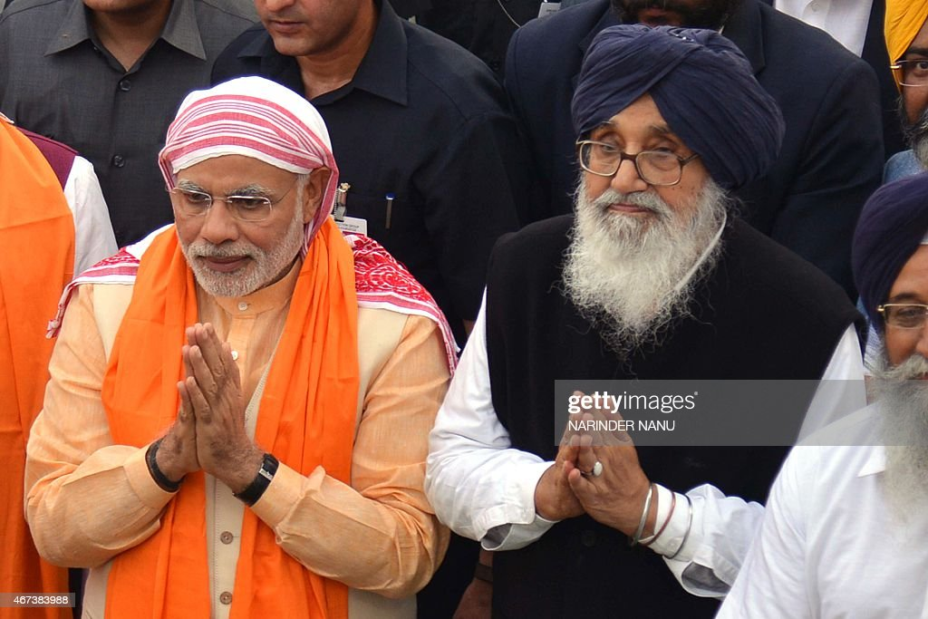 Indian Prime Minister <a gi-track='captionPersonalityLinkClicked' href=/galleries/search?phrase=Narendra+Modi&family=editorial&specificpeople=822611 ng-click='$event.stopPropagation()'>Narendra Modi</a> (L) gestures as he stands with Chief Minister of Punjab <a gi-track='captionPersonalityLinkClicked' href=/galleries/search?phrase=Parkash+Singh+Badal&family=editorial&specificpeople=3634862 ng-click='$event.stopPropagation()'>Parkash Singh Badal</a> (R) as they pay their respects at The Sikh Shrine Golden Temple in Amritsar on March 23, 2015. AFP PHOTO/NARINDER NANU