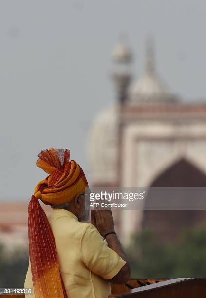 Indian Prime Minister Narendra Modi gestures to the crowd after delivering his speech for the country's 71st Independence Day celebrations which...
