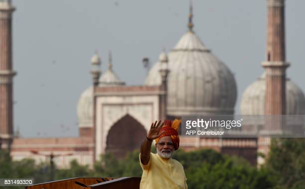 TOPSHOT Indian Prime Minister Narendra Modi gestures to the crowd after delivering his speech for the country's 71st Independence Day celebrations...