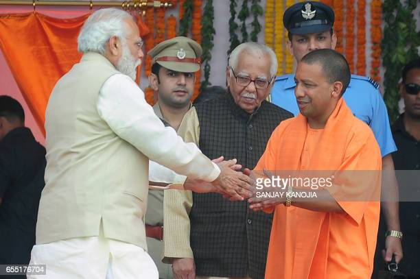 Indian Prime Minister Narendra Modi greets Chief Minister of Uttar Pradesh state Yogi Adityanath at his swearingin ceremony in Lucknow on March 19...