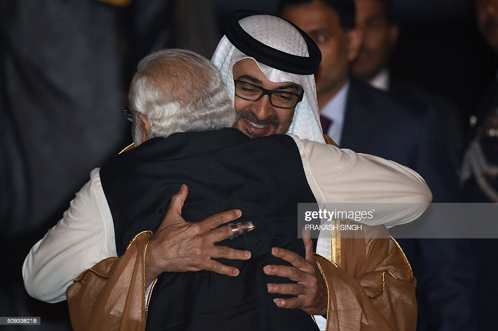 Indian Prime Minister Narendra Modi greets Crown Prince of Abu Dhabi Sheikh Mohammed Bin Zayed Al Nahyan (R) after the prince arrived at an air force base in New Delhi on February 10, 2016. Abu Dhabi's crown prince is on three day state visit to India. AFP PHOTO / Prakash SINGH / AFP / PRAKASH SINGH
