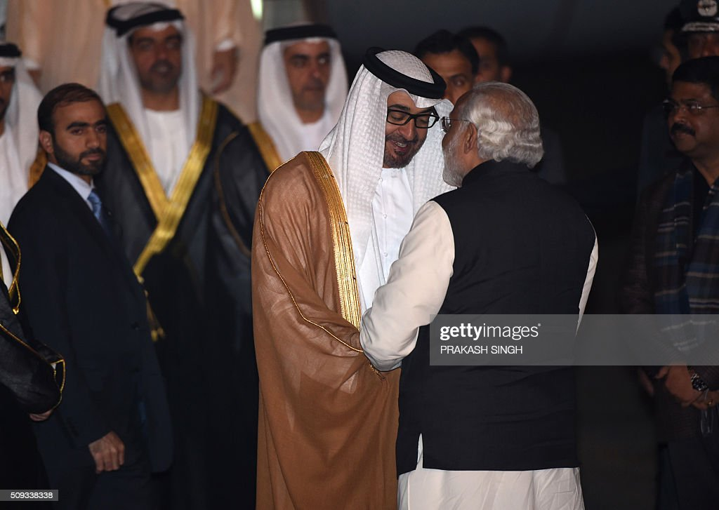 Indian Prime Minister Narendra Modi (R) greets Crown Prince of Abu Dhabi Sheikh Mohammed Bin Zayed Al Nahyan after the prince arrived at an air force base in New Delhi on February 10, 2016. Abu Dhabi's crown prince is on three day state visit to India. AFP PHOTO / Prakash SINGH / AFP / PRAKASH SINGH