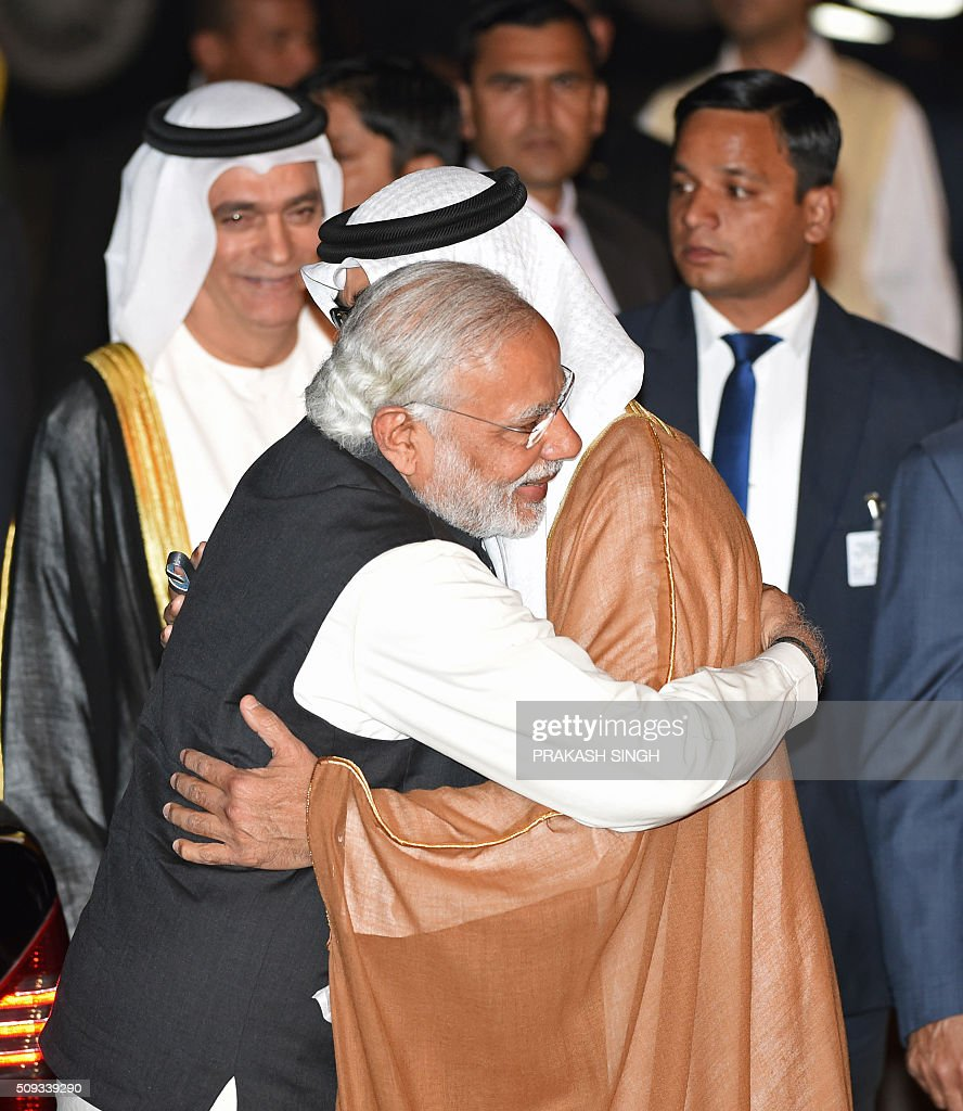 Indian Prime Minister Narendra Modi (L) greets Crown Prince of Abu Dhabi Sheikh Mohammed Bin Zayed Al Nahyan after the prince arrived at an air force base in New Delhi on February 10, 2016. Abu Dhabi's crown prince is on a three day state visit to India. AFP PHOTO / Prakash SINGH / AFP / PRAKASH SINGH
