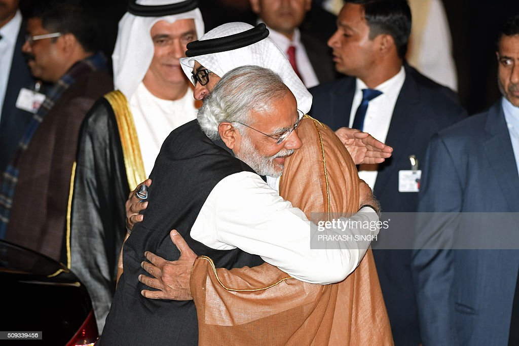 Indian Prime Minister Narendra Modi (L) greets Crown Prince of Abu Dhabi Sheikh Mohammed Bin Zayed Al Nahyan after the prince arrived at an air force base in New Delhi on February 10, 2016. Abu Dhabi's crown prince is on three day state visit to India. AFP PHOTO / Prakash SINGH / AFP / PRAKASH SINGH