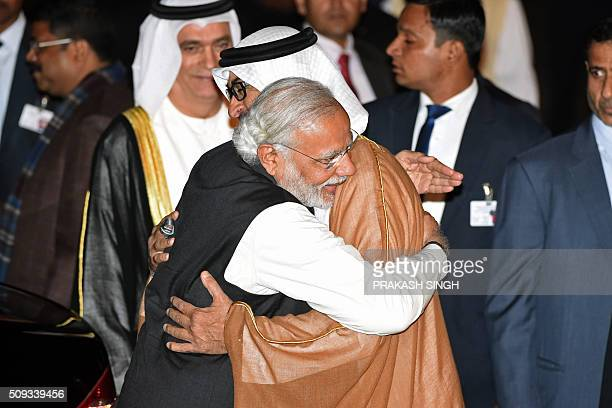 Indian Prime Minister Narendra Modi greets Crown Prince of Abu Dhabi Sheikh Mohammed Bin Zayed Al Nahyan after the prince arrived at an air force...
