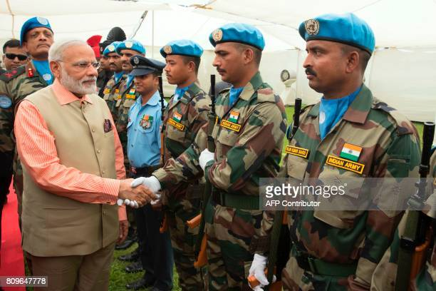 Indian Prime Minister Narendra Modi greets members of the Indian contingent of UNIFIL during a visit at the the Indian Army Cemetery of the World War...