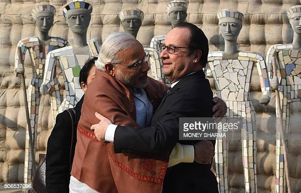 Indian Prime Minister Narendra Modi hugs French President Francois Hollande upon his arrival at the Rock Garden in Chandigarh on January 24 2016...
