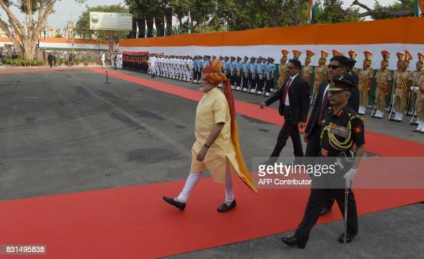 Indian Prime Minister Narendra Modi inspects a guard of honour during the country's 71st Independence Day celebrations which marks the 70th...
