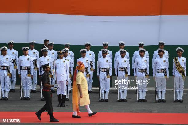 Indian Prime Minister Narendra Modi inspects a guard of honour following his arrival for the country's Independence Day celebrations which marks the...