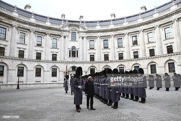 Indian Prime Minister Narendra Modi inspects a guard of honour outside the Treasury in London on November 12 2015 on the first day of a threeday...