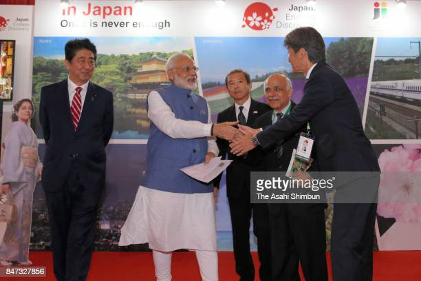 Indian Prime Minister Narendra Modi inspects a Japanese Tourism Exhibition with Japanese Prime Minister Shinzo Abe on September 14 2017 in Ahmedabad...