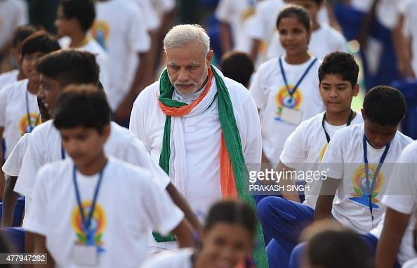 Indian Prime Minister Narendra Modi inspects Indian yoga practitioners as they take part in a mass yoga session to mark the International Yoga Day on...