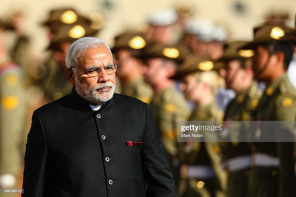 Indian Prime Minister Narendra Modi inspects the gaurd at Parliament House on November 18, 2014 in Canberra, Australia. Prime Minister Narendra Modi is attending meetings in Sydney, Canberra and Melbourne following the G20 Leaders Summit in Brisbane.