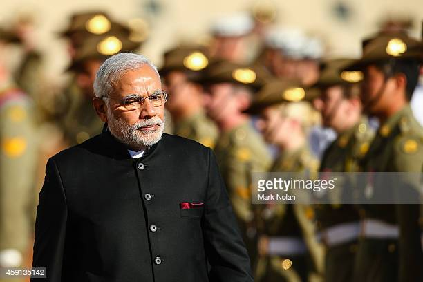 Indian Prime Minister Narendra Modi inspects the gaurd at Parliament House on November 18 2014 in Canberra Australia Prime Minister Narendra Modi is...