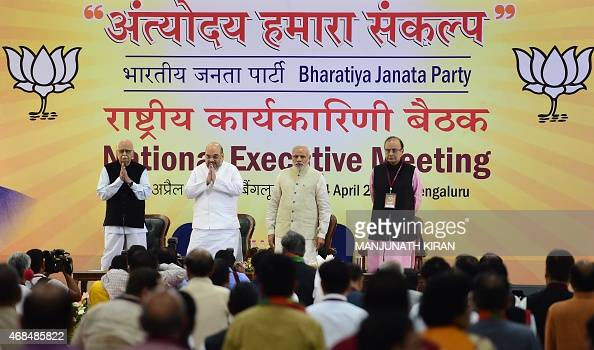Indian Prime Minister Narendra Modi is accompanied by Bharatiya Janata Party senior leader LK Advani BJP national president Amit Shah and Minister of...