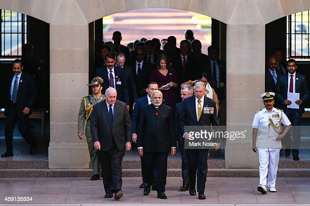 Indian Prime Minister Narendra Modi is escorted through the Australian War Memorial by retired Rear Admiral Ken Doolan AO and Australian Prime...