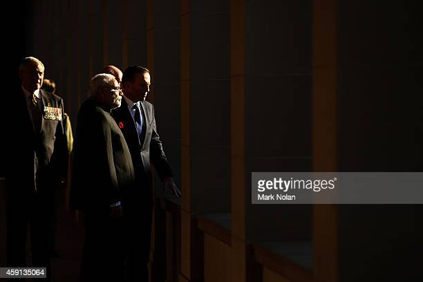 Indian Prime Minister Narendra Modi is escorted through the Australian War Memorial Australian Prime Minister Tony Abbott on November 18 2014 in...
