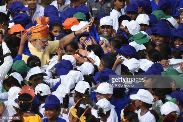 Indian Prime Minister Narendra Modi is surrounded by schoolchildren participating in the country's 71st Independence Day celebrations which marks the...