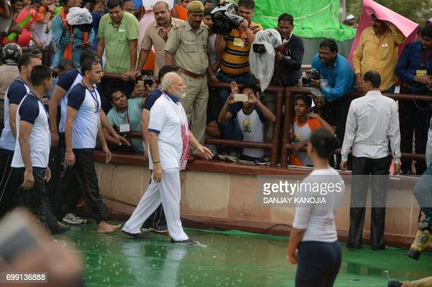 Indian Prime Minister Narendra Modi joins a mass yoga session along with other Indian yoga practitioners to mark the 3rd International Yoga Day at...